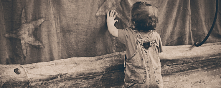 A boy leaning on the Wall