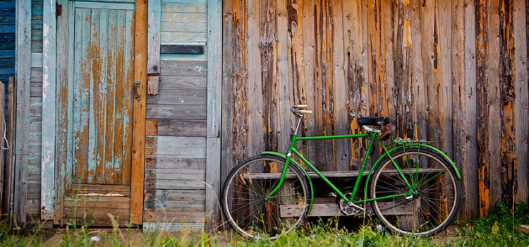 Old wooden wall and green bicycle